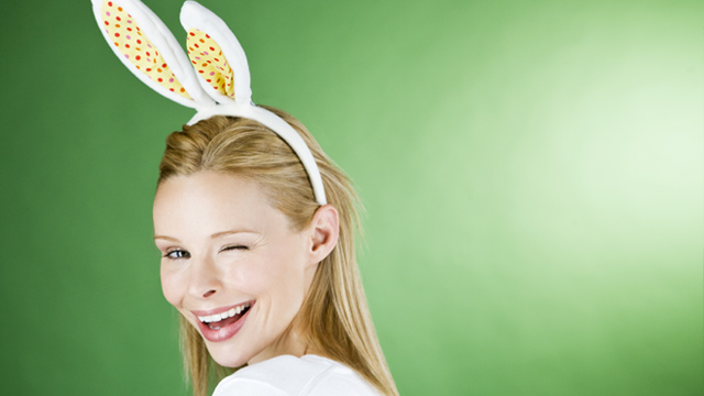 Happy woman with Easter bunny ears