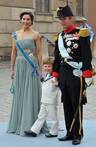 Mary, Frederik and Christian at the wedding of Sweden's Princess Victoria.