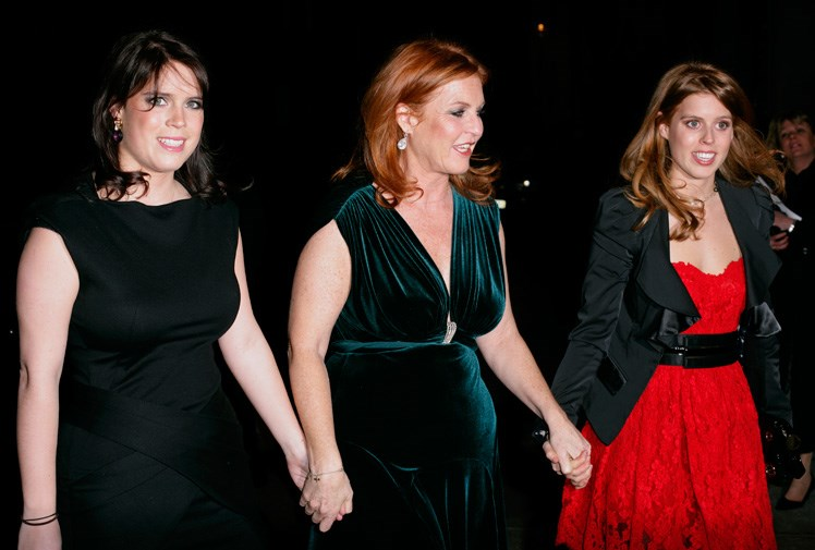 Princesses Beatrice and Eugenie and their mother at a charity event in March.