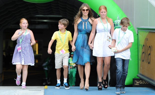 Liz Hurley plays happy families with Shane Warne's kids