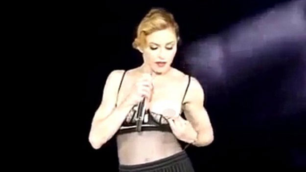 Is Madonna too old to flash her breasts onstage?
