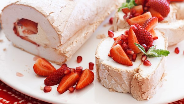 Strawberry and pomegranate pavlova roulade