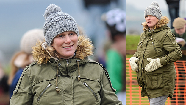 Zara Phillips couldn't keep her hands off her blossoming baby bump.
